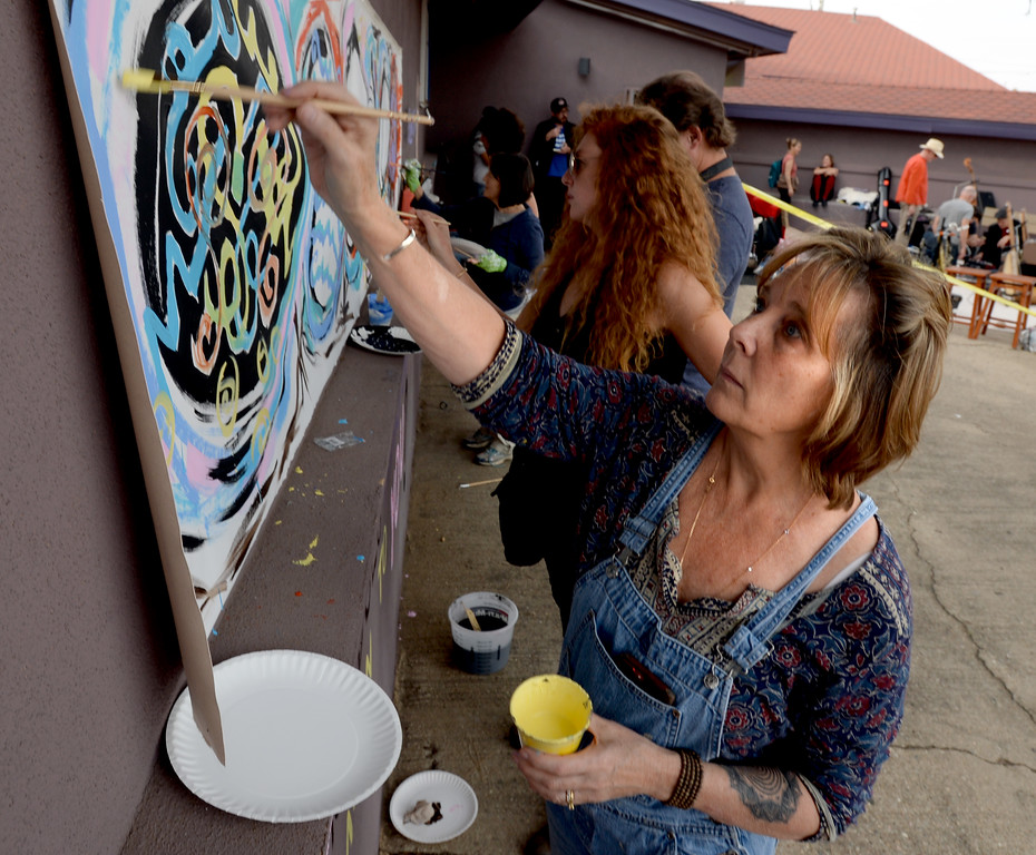 . BOULDER, CO - SEPTEMBER 29: Sue Wallingford, of Partners of Social Justice, helps paint a mural at the celebration. A celebration of dance was held at the Bustop to mark the occasion of the closing of the establishment on Saturday in Boulder.(Photo by Cliff Grassmick/Staff Photographer))