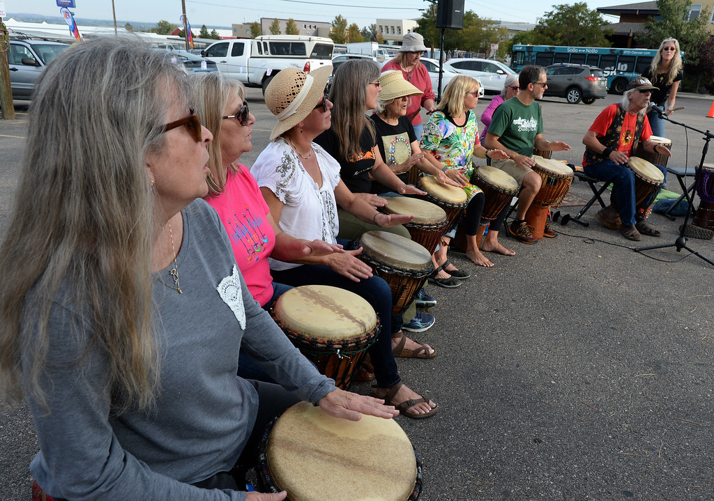 . BOULDER, CO - SEPTEMBER 29: Shaena Rodriguez, left, is part of the Djembe Orchestra of Longmont, that performed at the celebration. A celebration of dance was held at the Bustop to mark the occasion of the closing of the establishment on Saturday in Boulder.(Photo by Cliff Grassmick/Staff Photographer))