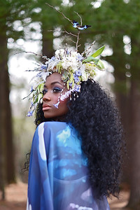 Photographer: Jennifer Ilene Model: Ashley Monique Makeup: Hannah Butler Makeup Artist with Imagine Three Floral headpiece: Susan Mcleary of Passionflower  Cape: El Costurero Real Corset: Jessica Crutchfiled of Ties that Bynde Designs, Inc