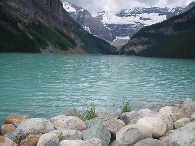 Like many lakes in the Rockies, Lake Louise's waters are glacial in origin. The remarkable colour of the water is caused by fine particles of suspended till called rock flour, which reflect the blue/green spectrum of light.