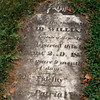 """David Williams' garvestone, lying flat in front of the monument. Note that it inscribed with the words """"one of the captors of Major Andre."""""""