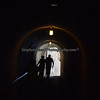 Couple tours the old fort in San Juan navigating its passageways.