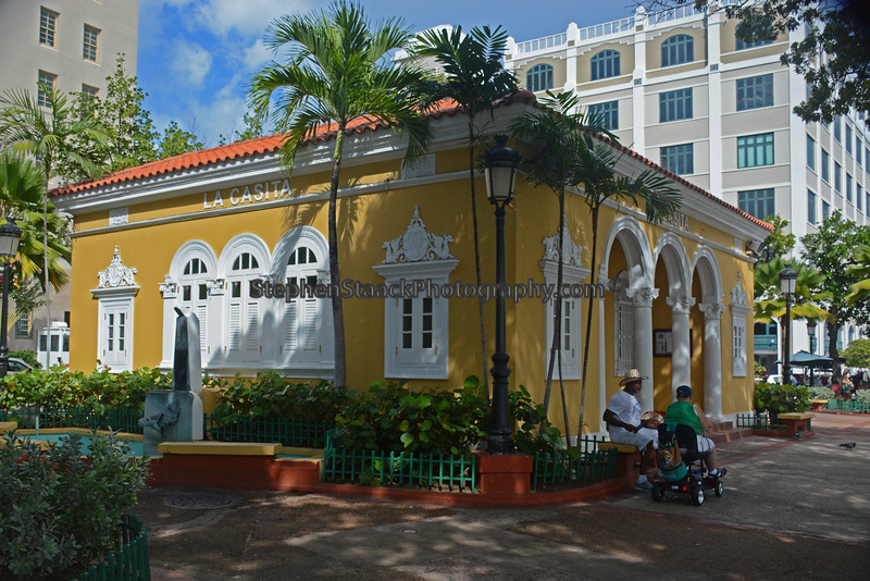 """People sitting outside """"La Casita"""" or little cottage in downtown San Juan's historic area."""