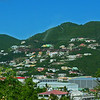 The tropical vegetation is dotted with houses on the hillsides Caribbean island of Saint Maarten.