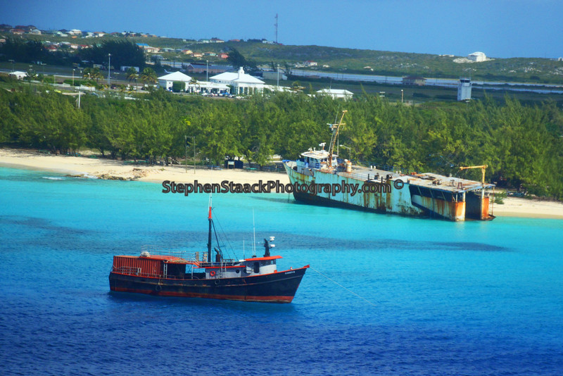 Two ships one aground,  one seaworthy are seen on the St. Marteen coastline.