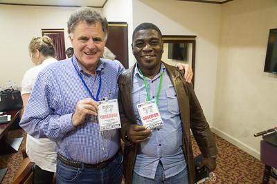 Monrovia, Liberia October 7, 2017 - Jordan Ryan and Pilate Johnson break between meetings.