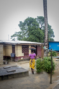 Monrovia, Liberia October 6, 2017 - A woman walks through a neighborhood in Monrovia.