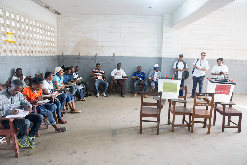 Monrovia, Liberia October 10, 2017 -  Election observers watch a polling room on election day.