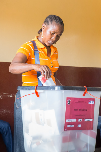 Monrovia, Liberia October 10, 2017 - A woman casting her vote on election day.