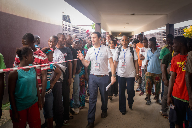 Monrovia, Liberia October 10, 2017 -  Jason Carter and madame Samba-Panza make their way through a hallway at a polling station on election day.