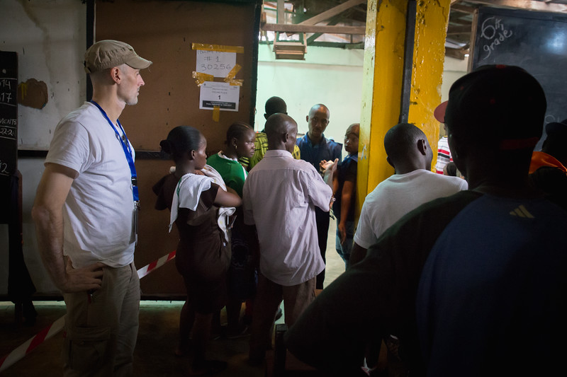 Monrovia, Liberia October 10, 2017 -  Nick Jahr looks on at a polling station on election day.