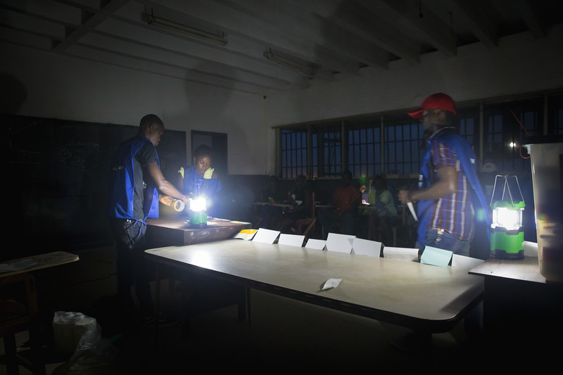 Monrovia, Liberia October 10, 2017 - Poll workers set up a room to begin counting votes on election day.