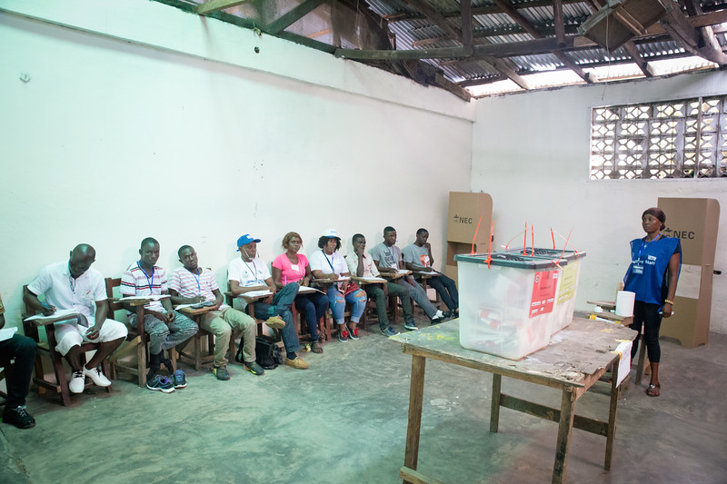 Monrovia, Liberia October 10, 2017 -  Ballot boxes, election observes and poll workers waiting for the next vote to be cast on election day.