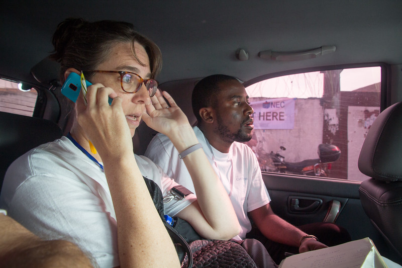 Monrovia, Liberia October 10, 2017 - Brett Lacy (left) and David Dean at work while driving between polling stations on election.