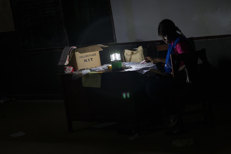 Monrovia, Liberia October 10, 2017 - Polling station workers still working after sunset on election day.