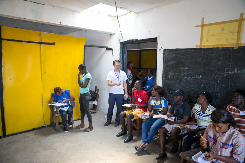 Monrovia, Liberia October 10, 2017 -  Jason Carter stops to talk to election observers at a polling station on election day.