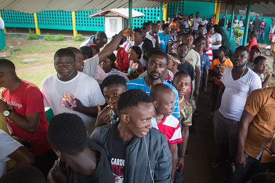 Monrovia, Liberia October 10, 2017 -  Voters stand in line at a polling precint on election day.