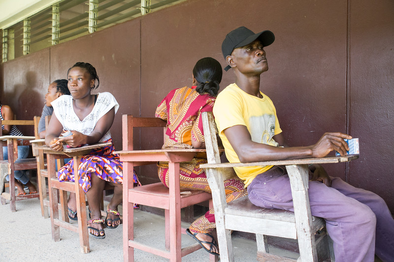 Monrovia, Liberia October 10, 2017 -  Voters wait to move up one chair as a voting line moves forward on election day.