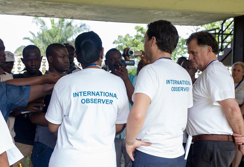 Monrovia, Liberia October 10, 2017 -  Jordan Ryan, Jason Carter and Madame Samba-Panza hold a press conference at a polling station on election day.