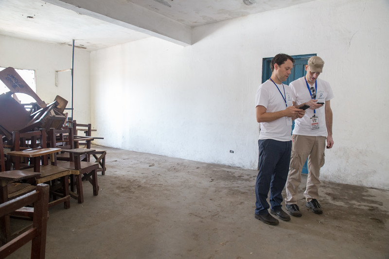Monrovia, Liberia October 10, 2017 -  Jason Carter and Nick Jahr review notes at a polling station on election day.