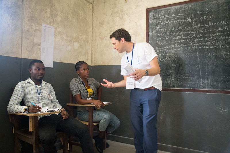 Monrovia, Liberia October 10, 2017 -  Jason Carter speaks with election observers at a polling station on election day.
