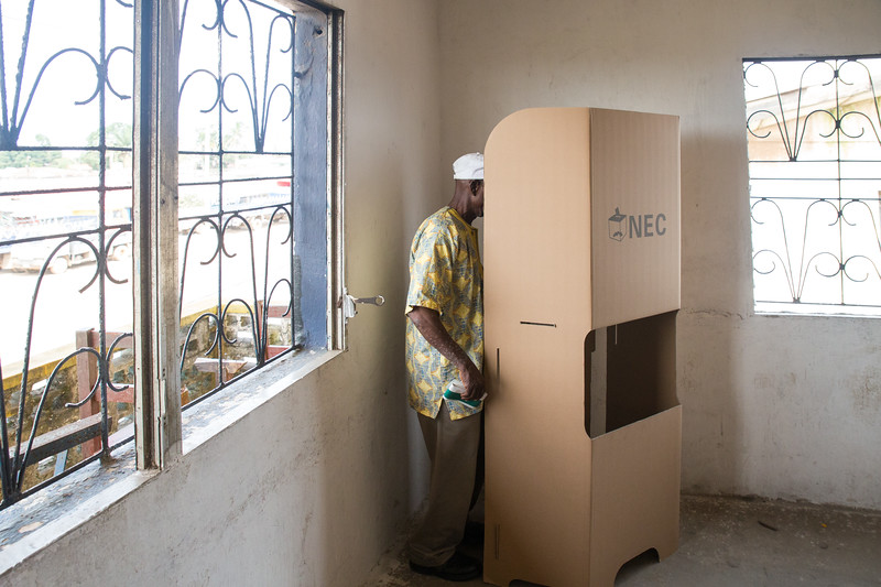 Monrovia, Liberia October 10, 2017 -  A man enters a voting booth on election day.
