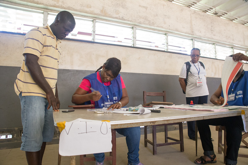 Monrovia, Liberia October 10, 2017 -  Madame Samba-Panza watches activites at a polling station on election day.