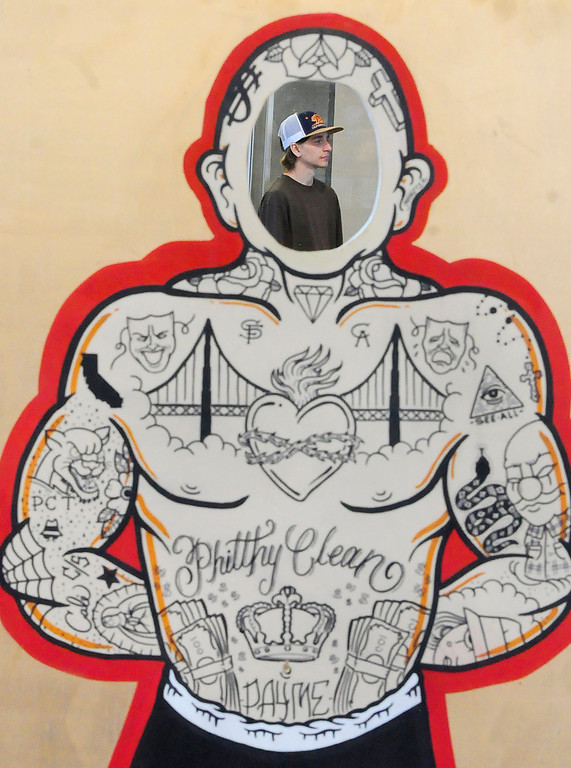 . (Chris Riley/Times-Herald) A tattoo enthusiast can be seen through a cutout tat the Philthy Clean tattoo station during The Catalyst Tattoo Expo at the Solano County Fairgrounds in Vallejo on Friday.