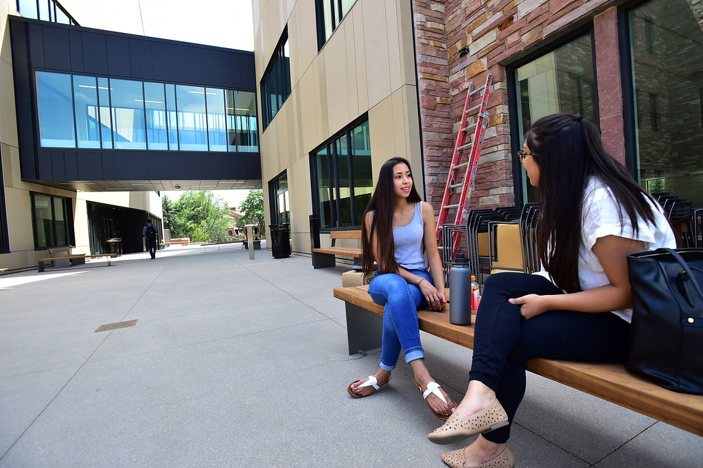 . CU students Lluvia Macia, left, and Adela Aguirre, talk outside the Center for Academic Success and Engagement (CASE) on Friday on the University of Colorado Campus in Boulder. For more photos go to dailycamera.com Paul Aiken Staff Photographer
