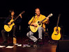 Chris Yeaton, Adam Werner & Brenda Lipincott on Hawaiian slack key & American fingerstyle guitar, January 22, 2010 : Chris Yeaton told us something about how the Hawaiian slack key guitar style originated.  It was introduced to the islands by Mexican cowboys.  When they left, Hawaiians adapted the slack key style to Hawaiian music.  Most slack-key tunings are derived from a classically tuned guitar, which is detuned by slacking the strings until they form a single cord.  (http://en.wikipedia.org/wiki/Slack-key_guitar)  Chris was born in Hawaii and learned from master slack-key guitarists Keola Beamer and John Keawe.  He and Adam Werner are among the featured musicians of the Woodsong Acoustics Group (http://www.woodsongacoustics.com).  Adam Werner, from Los Angeles, is a solo acoustic guitarist who plays unconventional fingerstyle guitar (http://en.wikipedia.org/wiki/Fingerstyle_guitar) with provocative percussive elements.  He plays extensively as a solo guitarist and together with Chris Yeaton and the Woodsong Acoustics Group.  Learn more about Chris and Adam, and about Brenda Lippincott who joined them for this concert, at: 	http://www.woodsongacoustics.com/music/yeaton.php 	http://www.adamwerner.com/Home.html 	http://www.acousticguitarcommunity.com/profile/brendalippincott?xg_source=activity