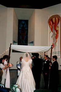 Jewish/Christian Couple Standing Under the Huppah in a Baptist Church During Their Marriage Ceremony