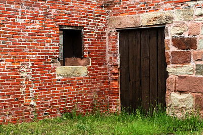 Street side door for the prison yard with window looking out onto the Black Smith shop. Old New Gate Prison, East Granby CT.