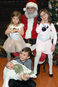 Santa Claus greets the Weckesser kids, Emily, Claire, Benjamin, and Reed of Wall, New Jersey at the Dinner with Santa event at the InfoAge Science History Learning Center and Museum in Wall, New Jersey on 12/13/2018. (STEVE WEXLER/THE COAST STAR).