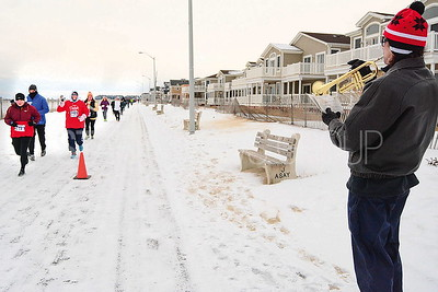 "r. dave deMonico. ocean twp. playing for the runners. he said his trumpet kept ""freezing up"" in the cold."