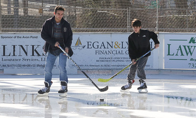"TJ McLaughlin and his younger brother Jack [on right] playing hockey. Avon Pond's ""free skate"" session in Avon By The Sea, NJ on 12/29/18. [DANIELLA HEMINGHAUS 