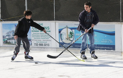 "Avon residents, TJ McLaughlin and his younger brother Jack [on left] playing hockey. Avon Pond's ""free skate"" session in Avon By The Sea, NJ on 12/29/18. [DANIELLA HEMINGHAUS 