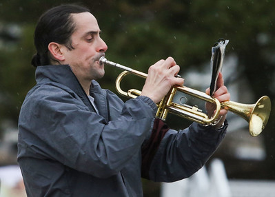 Dave DeMonico, from Ocean, playing trumpet for the runners. The 2018 Twilight Run in Manasquan, NJ on 12/21/18. [DANIELLA HEMINGHAUS | THE COAST STAR]