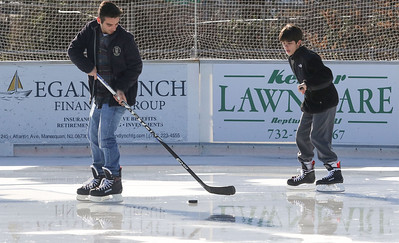 "TJ McLaughlin and his younger brother Jack [on right], from avon, playing hockey. Avon Pond's ""free skate"" session in Avon By The Sea, NJ on 12/29/18. [DANIELLA HEMINGHAUS 