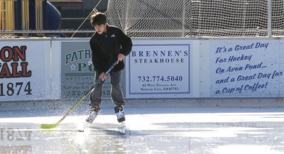 "Jack McLaughlin, from Avon, playing hockey. Avon Pond's ""free skate"" session in Avon By The Sea, NJ on 12/29/18. [DANIELLA HEMINGHAUS 