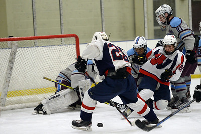#25, Joe Velke of the Wall High School Varsity Ice Hockey Team tries to get a shot on the Toms River South-East goal as #90, Dan Mitrione looks on in their game played on 12/26/2018. (STEVE WEXLER/THE COAST STAR).