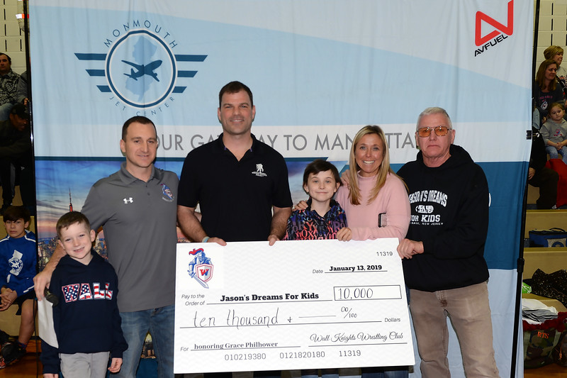 A Wrestling Fundraiser to help support Jason's Dreams For Kids was held at Wall Township High School. Seen in the photo are Nolan and Michael Paenell, MC of the event, Rob Philhower, Honoree Grace Philhower, Jackie Philhower, and Dennis McGinnis of Jason's Dreams For Kids on 01/13/2019.(STEVE WEXLER/THE COAST STAR).