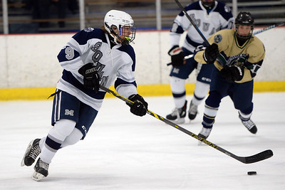 #9, Michael Farinacci of the Manasquan Varsity Ice Hockey Team moves the puck down the ice in the game played against Freehold on 01/16/2019. (STEVE WEXLER/THE COAST STAR).
