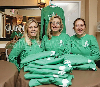 SQ beach house BMR parade fundraiser//  Megan Levis, Kacey Casserly and Michelle Casserly selling this years parade shirts