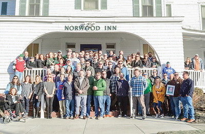 previous employees gathering in front of the norwood