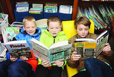 SG Elementary Library Research// L to R: Elijah B 9. Luke B 10. and Chris C 10