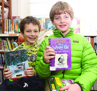 SG Elementary Library Research// L to R: Brandon K 9 and Ryan P 10