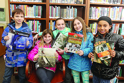 SG Elementary Library Research// L to R: Ryan S 9. Leah C 9. Katherine K 10. Dylan C 9. and Zoe K 9