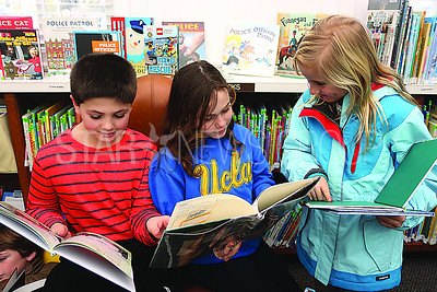 SG Elementary Library Research// L to R: Henry C 10. Isabella B 9. and Rylie P 9