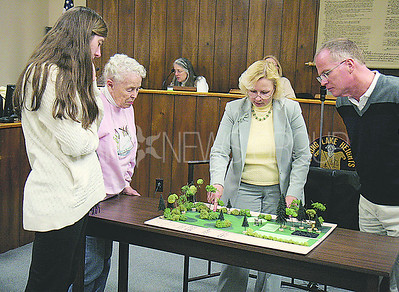 SLH Environmental Commission Kat Crippen (center) showing the model to SLH residents (left to right) Katie Nolan, Wanda Shoppell, Rich Diver,