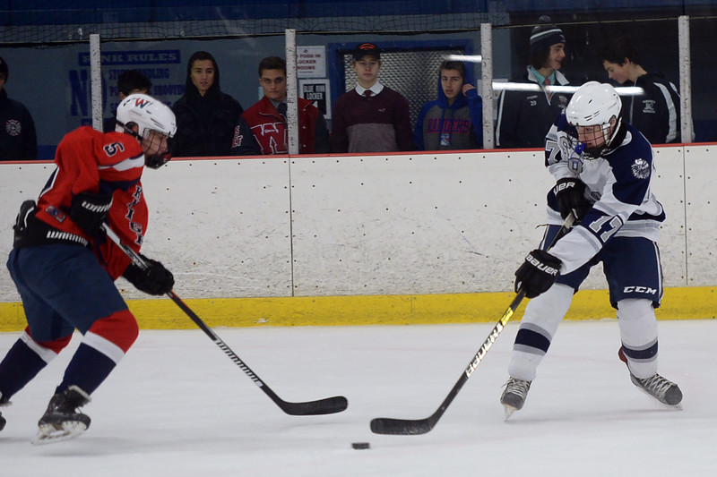 #17, Ryan Scott of the Manasquan High School Boy's Varsity Ice Hockey Team takes a shot on the Wall Township High School net in the game played at the Jersey Shore Arena on 01/30/2019.